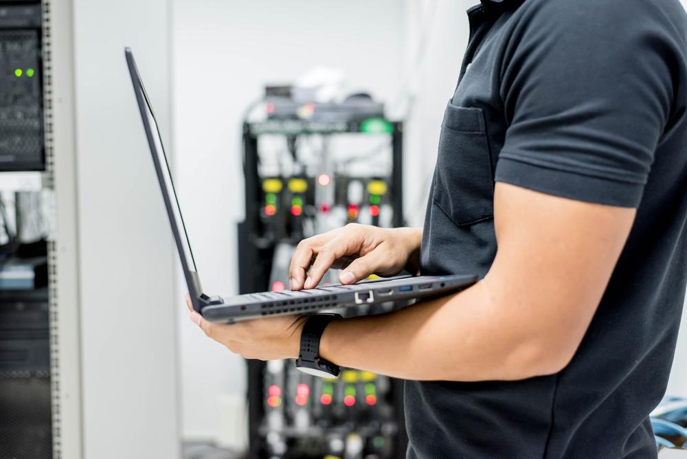 hands of the technician repairing a computer,Computer engineer working concept.